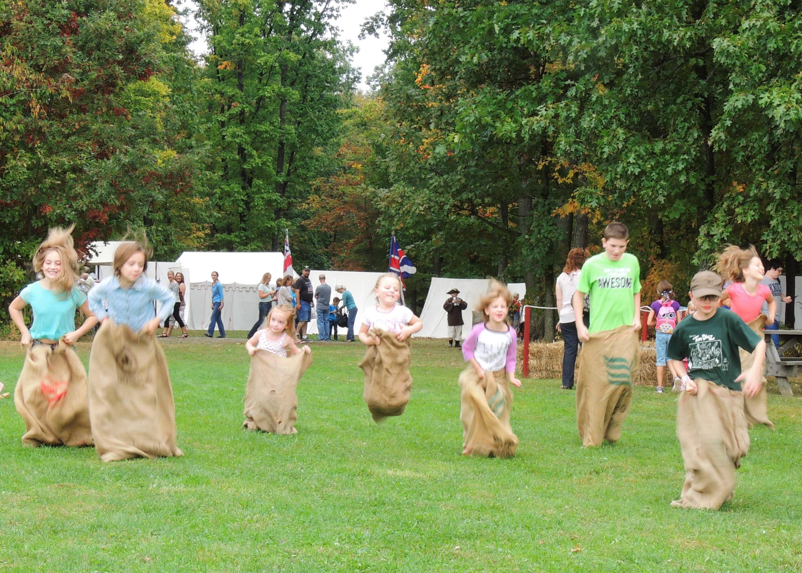 children in a potato sack race